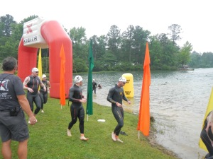 Running into water (2nd to the right) for start of 2nd swim lap.
