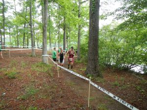 Passing near finish area to start 2nd half of 10K trail run.